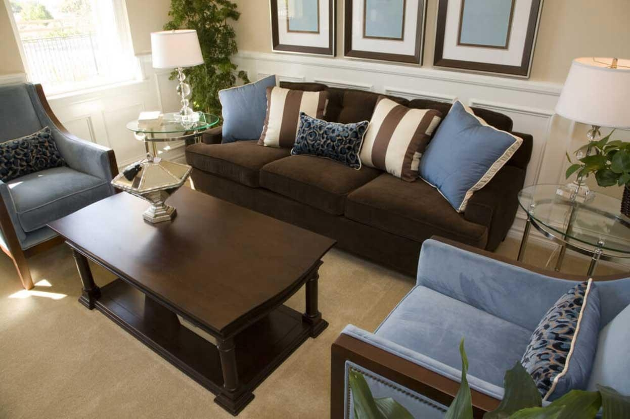 Brown And Blue Living Room Decor With Dark Brown Sofa | Home Within Brown Sofa Chairs (View 5 of 20)