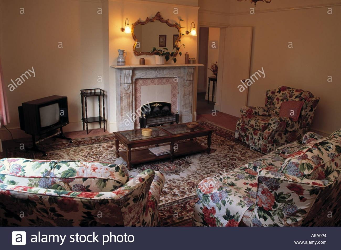 Chintz Sofa And Armchairs In Dated Living Room With Television In Intended For Chintz Floral Sofas (Image 17 of 22)