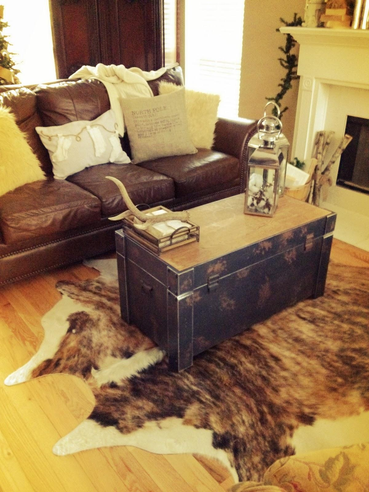 Decorating: Traditional Living Room Design With White Coffee Table With Cowhide Sofas (Image 9 of 20)