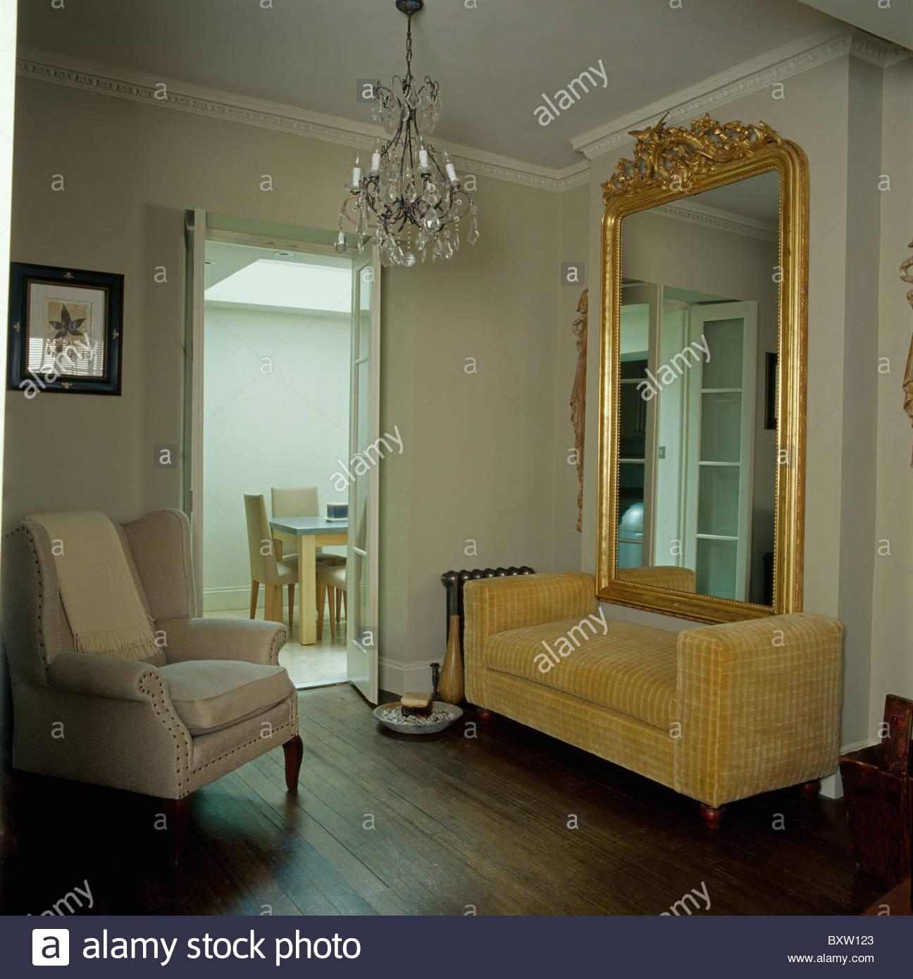 Large Ornate Antique Gilt Mirror Above Beige Velvet Sofa In Living Pertaining To Mirror Above Sofas (Image 7 of 20)