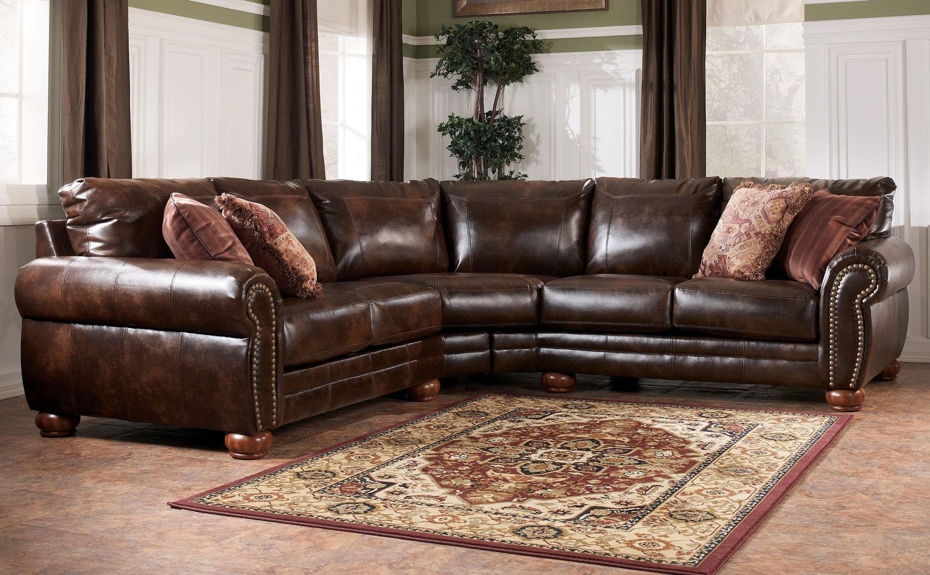 Living Room: Brown Leather And Fabric Sectional Sofa ~ Nila Homes Throughout Ashley Faux Leather Sectional Sofas (View 4 of 20)