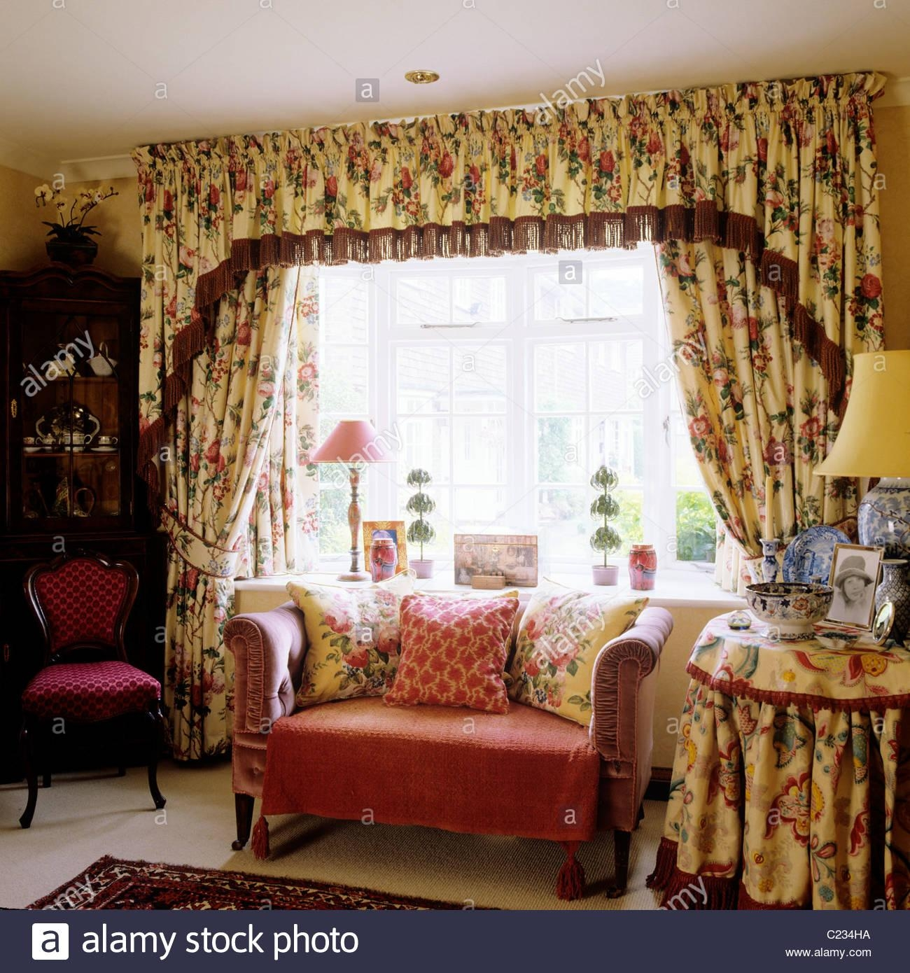 Small Sofa In Front Of Window With Floral Patterned Curtains And Inside Chintz Floral Sofas (View 11 of 22)