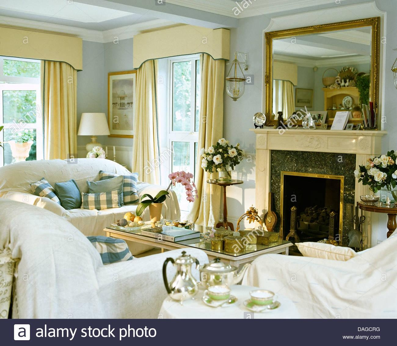 White Throws On Sofas In Pale Blue Living Room With Large Mirror Throughout Mirror Above Sofas (View 19 of 20)