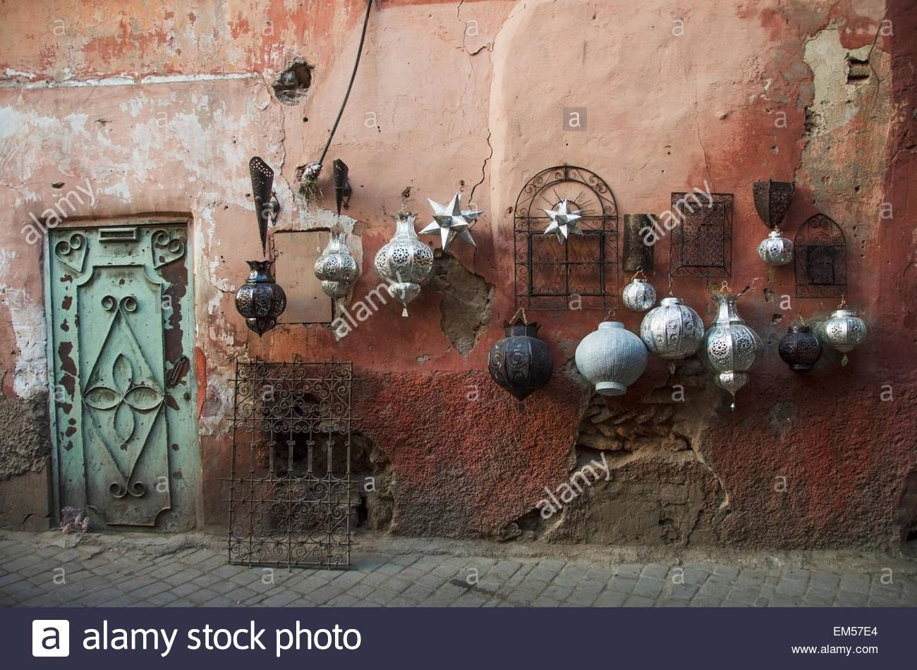Decorative Baubles And Metal Wall Art On Display On Old Wall With Regard To Moroccan Metal Wall Art (View 15 of 20)