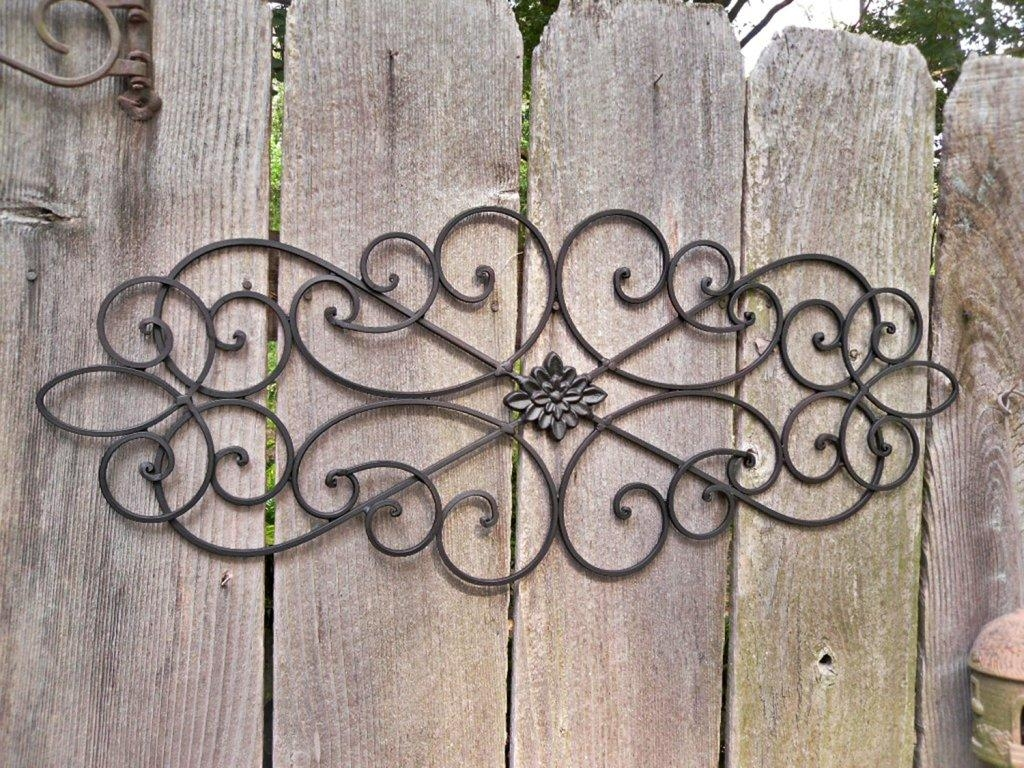 How To Outdoor Metal Wall Decor Drilling Holes In The Siding For Iron Gate Wall Art (Image 12 of 20)