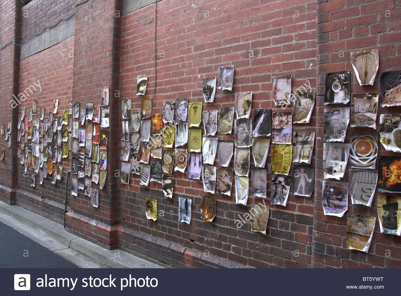 Artwork Hanging On Brick Wall In Melbourne, Australia Stock Photo With Hanging Wall Art For Brick Wall (Image 2 of 20)