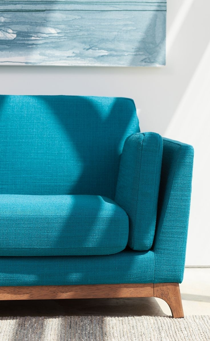 Beautiful, Solid Honey Oak Base Grounds This Vibrantly Colored Mid With Turquoise Sofas (Image 1 of 10)