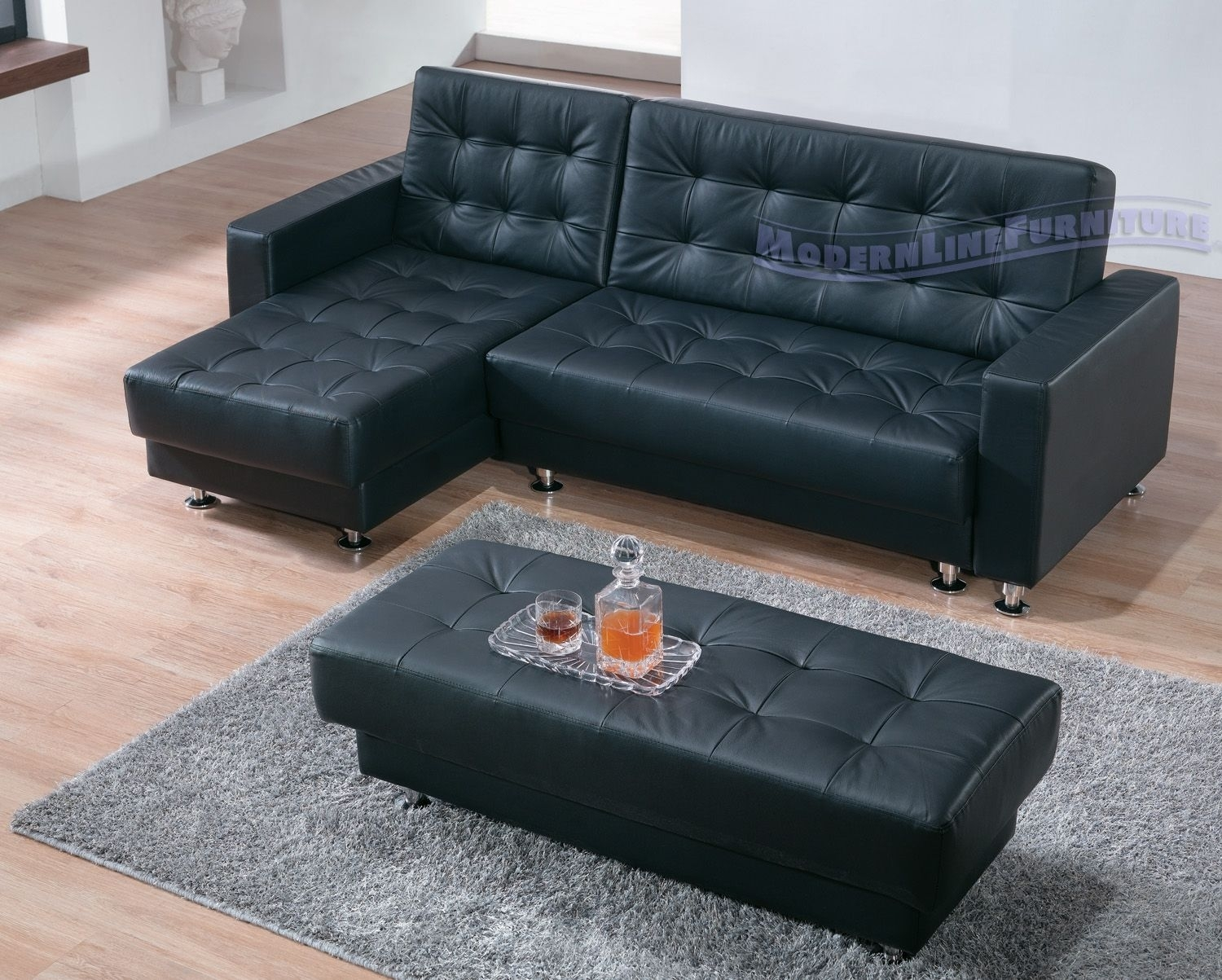 Black Leather Modern Sectional Sofa Sleeper With Ottoman | For The In Sectional Sleeper Sofas With Ottoman (View 6 of 10)