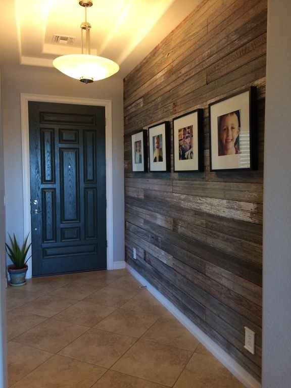 Entry With Unique Door And Wood Wall (View 6 of 15)