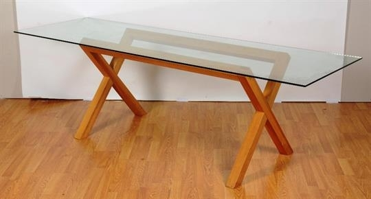 A Contemporary Glass Dining Table, The Rectangular Top On Oak With Regard To Glass Dining Tables With Oak Legs (View 5 of 25)