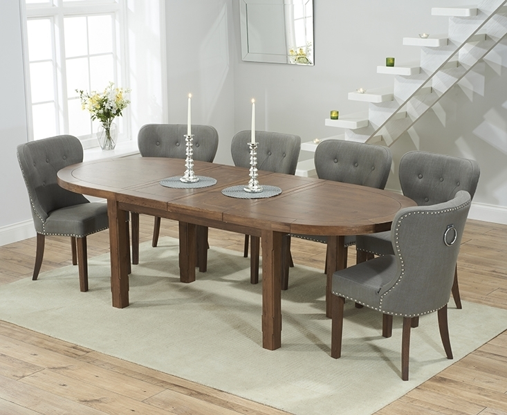 Agata Solid Dark Oak Oval Extending Dining Set With 4 Vicenza Grey Within Oval Extending Dining Tables And Chairs (Image 3 of 25)