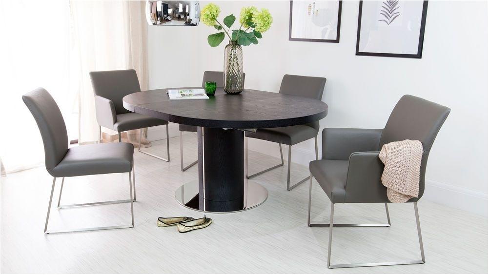 Beautifull Black Ash Round Extending Dining Table Pedestal Base Uk Pertaining To Black Extending Dining Tables (Image 2 of 25)