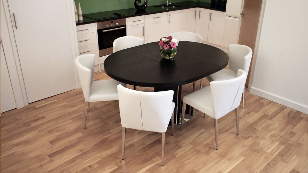 Black Ash Round Extending Dining Table | Pedestal Base | Uk Pertaining To Extendable Dining Sets (Image 2 of 25)