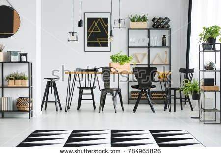 Black Chairs At Dining Table In Bright Dining Room With Ferns And Pertaining To Scandinavian Dining Tables And Chairs (Image 8 of 25)