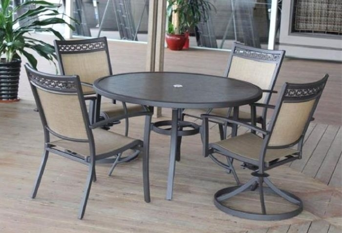 Carmadelia Outdoor 5 Piece Round Dining Set In Tan/brown Throughout Grady 5 Piece Round Dining Sets (Image 3 of 25)