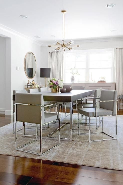 Contemporary Dining Room Features A Brass And Glass Sputnik Throughout Chrome Dining Room Chairs (View 7 of 25)