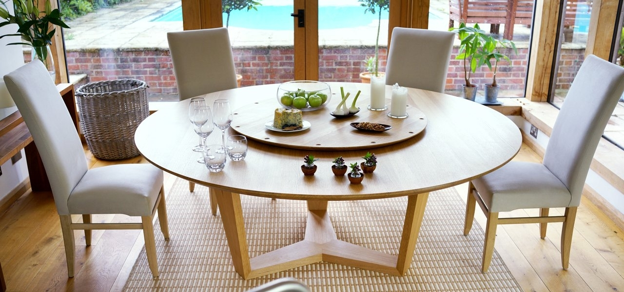 Contemporary Round Dining Table | Round Extending Dining Tables With Regard To Round Dining Tables Extends To Oval (Image 3 of 25)