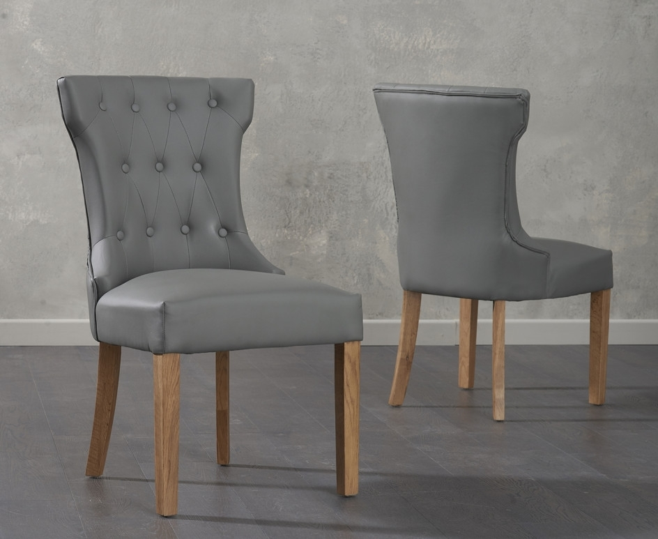 Cora Grey Faux Leather Dining Chairs | The Great Furniture Trading Intended For Cora 7 Piece Dining Sets (Image 4 of 25)