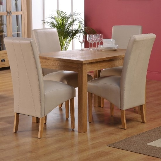 Corrick Dining Table And 4 Ivory Faux Leather Dining Chairs Throughout Ivory Leather Dining Chairs (Image 8 of 25)
