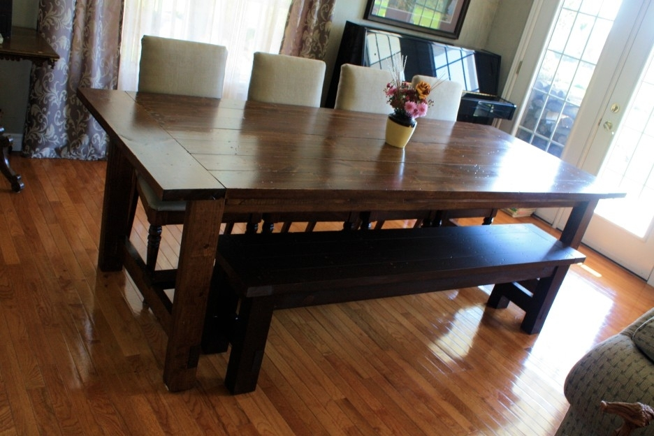 Dark Brown Stained Oak Wood Dining Table With Black Bench Combined Throughout Dark Brown Wood Dining Tables (Image 8 of 25)