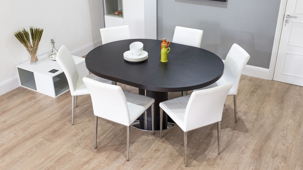 Dark Wood Round Extending Dining Table | White Or Grey Faux Leather Intended For White Round Extendable Dining Tables (Image 7 of 25)