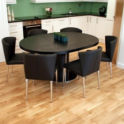 Free Assembly On The Modern Curva Round Extending Dining Tables Pertaining To Black Extending Dining Tables (Image 13 of 25)