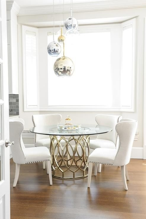 Gorgeous Dining Room Features Staggered Brass, Glass, And Chrome With Lassen 5 Piece Round Dining Sets (Image 17 of 25)