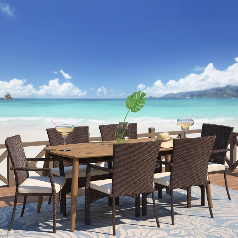 Highland Dunes Soeren 7 Piece Dining Set With Cushions & Reviews Pertaining To Leon 7 Piece Dining Sets (View 16 of 25)