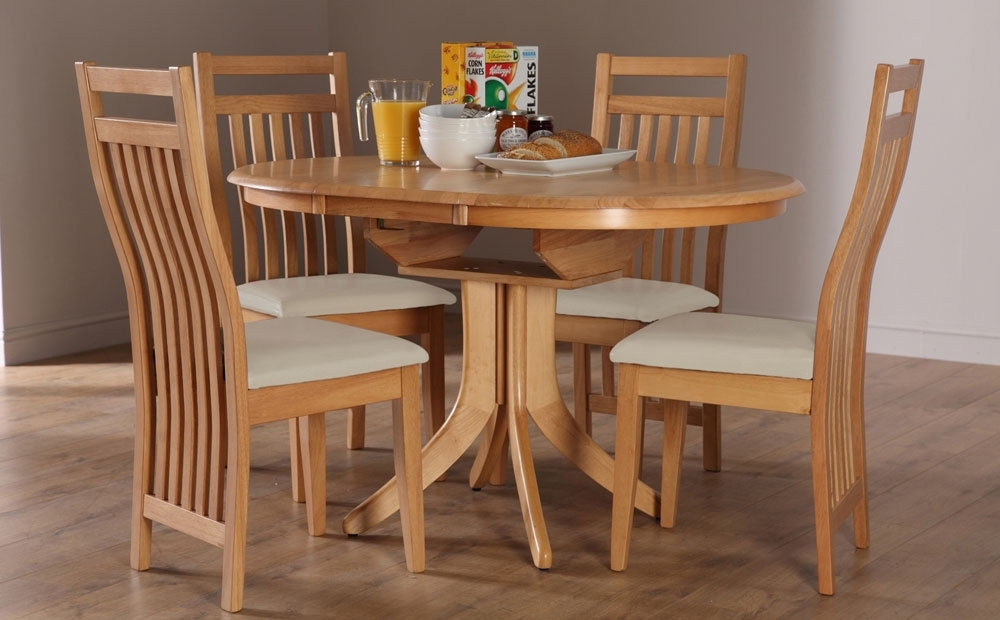 Hudson Bali Round Extending Oak Dining Table And 4 6, Oak Extending throughout Round Oak Dining Tables and Chairs