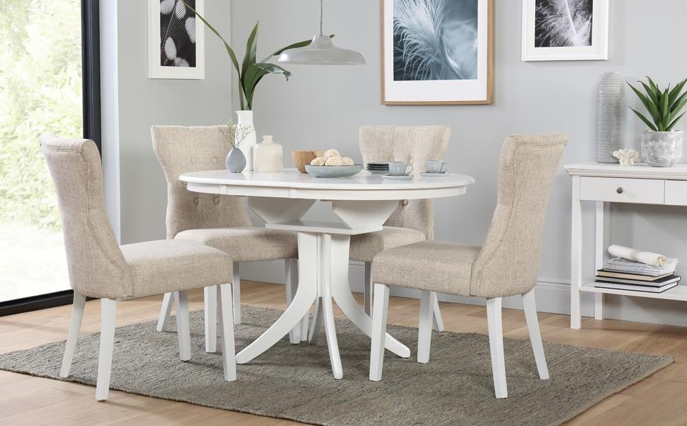 Hudson Round White Extending Dining Table With 4 Bewley Oatmeal Throughout Round White Extendable Dining Tables (Image 10 of 25)