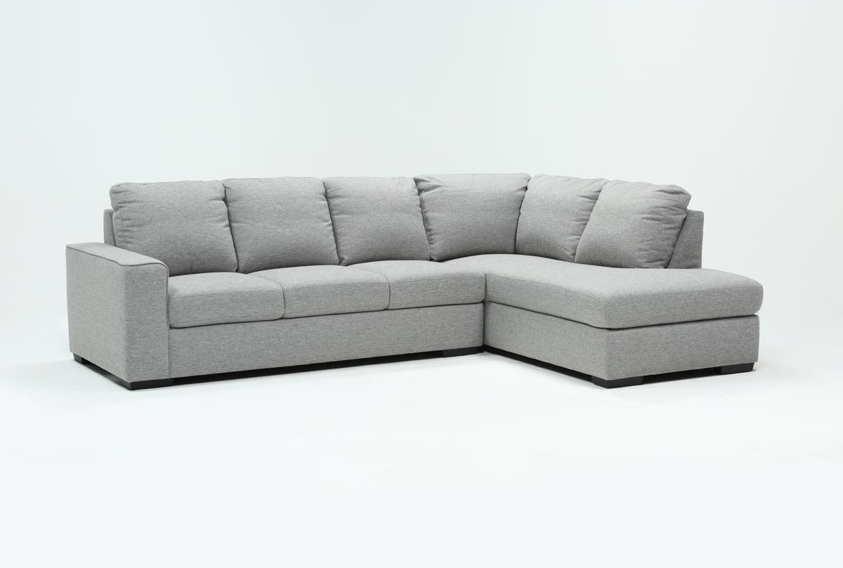 Lucy Grey 2 Piece Sleeper Sectional W/raf Chaise | Living Spaces With Regard To Lucy Dark Grey 2 Piece Sectionals With Laf Chaise (Image 21 of 25)