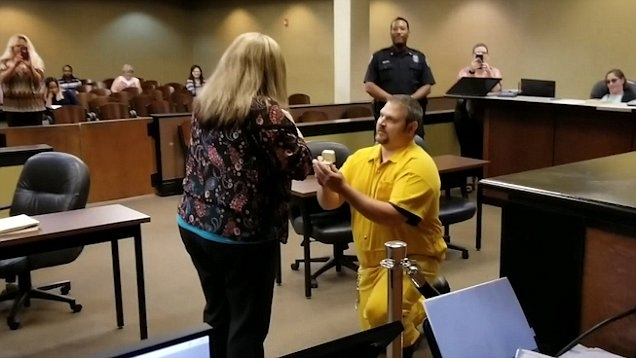 Man Appears In Shackles To Propose To Mississippi Probation Officer In Combs 5 Piece 48 Inch Extension Dining Sets With Pearson White Chairs (Image 19 of 25)