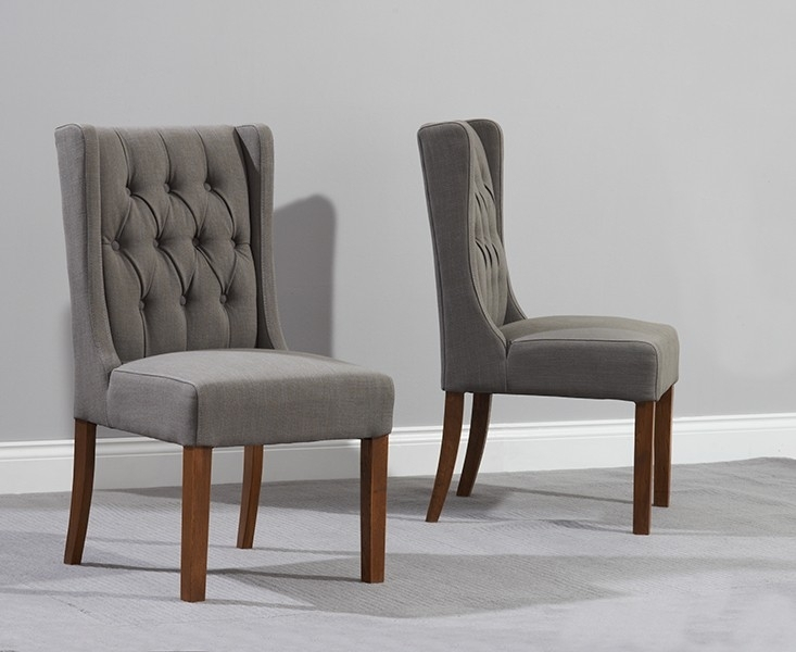 Pair Of Stefini Grey Upholstered Buttoned Dining Chairs Dark Legs Regarding Grey Dining Chairs (View 4 of 25)