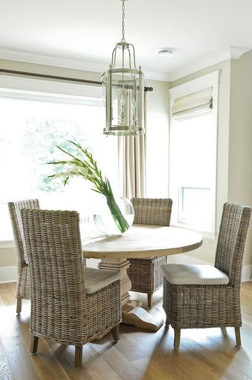 Round Salvaged Wood Dining Table With Wicker Dining Chairs For Rattan Dining Tables (View 13 of 25)