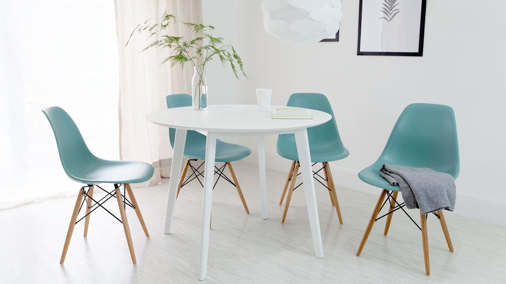 Round White Dining Table And Eames Dining Chair Set |Uk Intended For White Circle Dining Tables (Image 14 of 25)