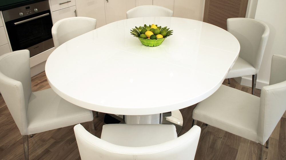 Round White Gloss Extending Dining Table | Pedestal Base Inside Round Dining Tables Extends To Oval (Image 24 of 25)