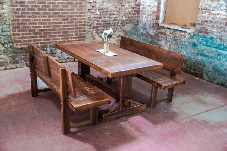 Rustic Farm Table With Bench Having Back Plus Exsposed Brick Wall Pertaining To Bench With Back For Dining Tables (Image 22 of 25)