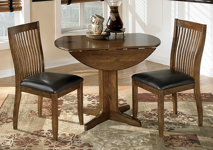 Select Imports Furniture And Decor Stuman Round Drop Leaf Table W/2 Within Craftsman 9 Piece Extension Dining Sets With Uph Side Chairs (Image 20 of 25)