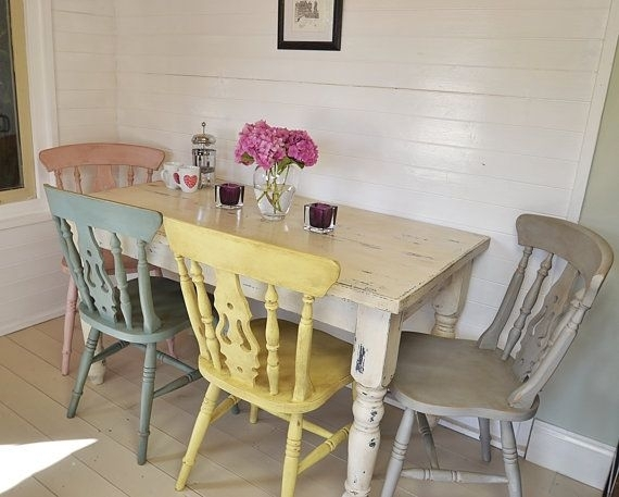 Shabby Chic Farmhouse Dining Table With Four Multicoloured Chairs Throughout Shabby Chic Dining Chairs (View 3 of 25)