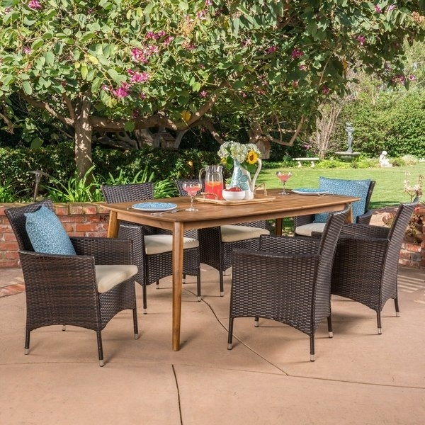 Shop Jaxon Outdoor 7 Piece Multibrown Pe Wicker Dining Set With With Regard To Jaxon Grey 5 Piece Round Extension Dining Sets With Upholstered Chairs (View 15 of 25)
