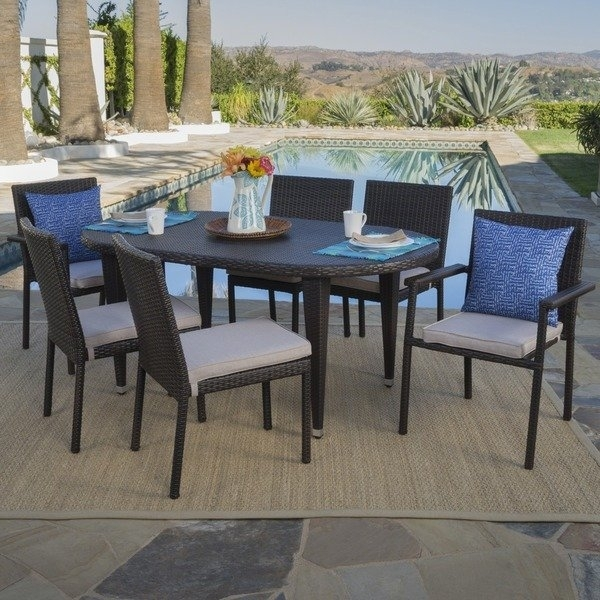 Shop Logan Outdoor 7 Piece Oval Wicker Dining Set With Cushions Regarding Logan 7 Piece Dining Sets (Image 14 of 25)