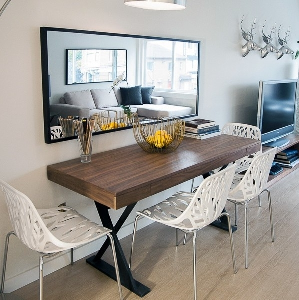 Sleek Minimalist Dining Table With Mirror Wall Accent Inside Sleek Dining Tables (Image 20 of 25)