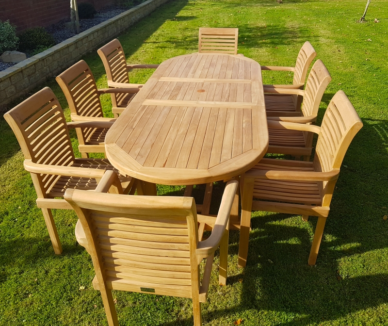 Teak Garden Furniture Extending Teak Dining Table With 8 Stacking Chairs With Garden Dining Tables (View 15 of 25)