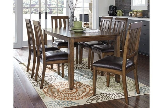 The Puluxy 7 Piece Dining Set Makes Having A Meal All The More Throughout Chandler 7 Piece Extension Dining Sets With Fabric Side Chairs (Image 22 of 25)
