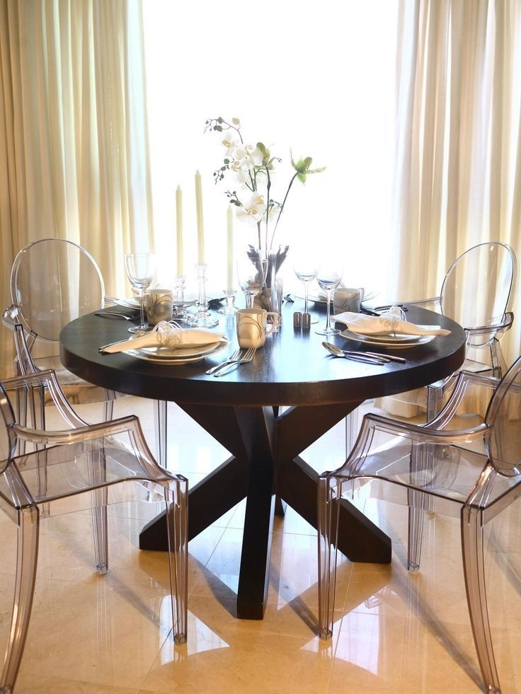 This Elegant Dining Room Features A Large Round Wood Dining Table Inside Clear Plastic Dining Tables (View 17 of 25)