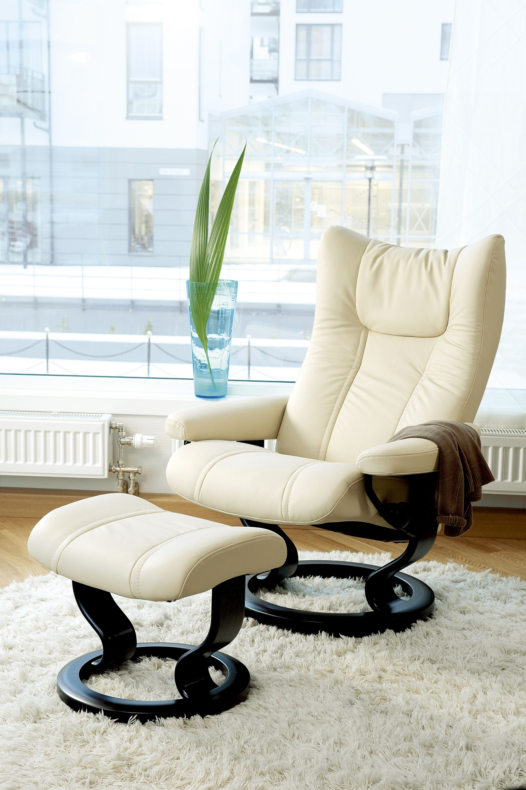 A Stylish Cream Recliner And Ottoman Perfect For The Modern Pertaining To Katrina Beige Swivel Glider Chairs (View 18 of 25)