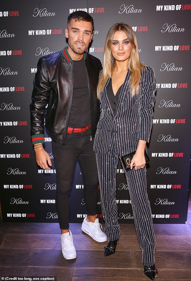 Best And Newest Kilian Black 74 Inch Tv Stands Inside Chloe Lloyd Cosies Up To Union J's Josh Cuthbert At Perfume Event (View 11 of 15)