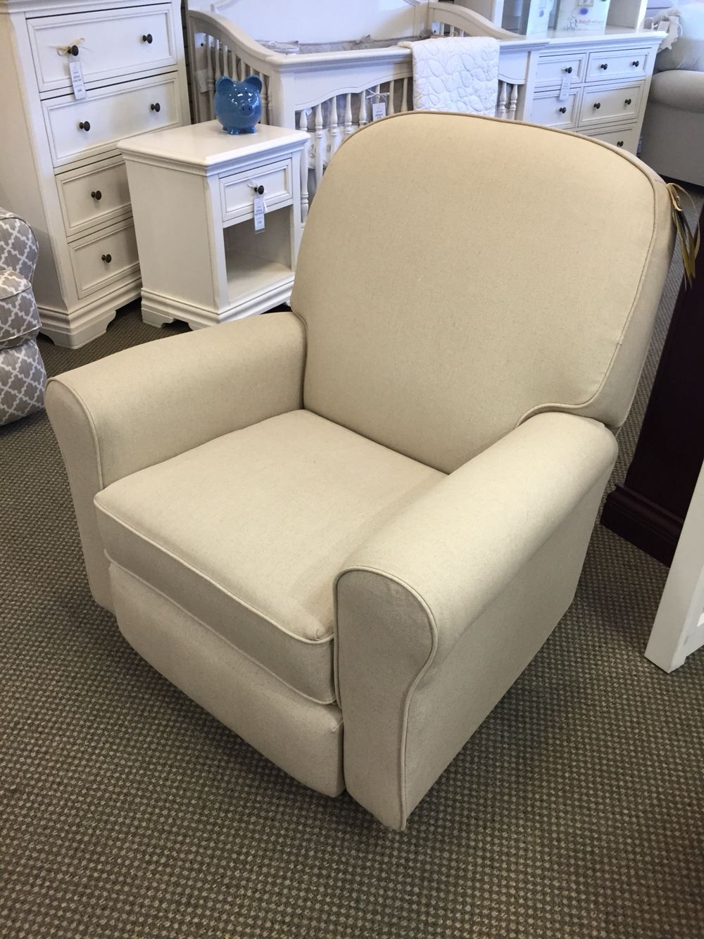 Best Chairs – Benji Swivel Glider Recliner In Burlap (27159) Stock Within Bailey Linen Flare Arm Wing Skirted Swivel Gliders (View 6 of 25)