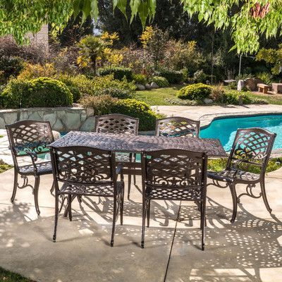 Fleur De Lis Living Ravenna Cast Aluminum 7 Piece Outdoor Dining Set With Tarleton 5 Piece Dining Sets (View 13 of 25)