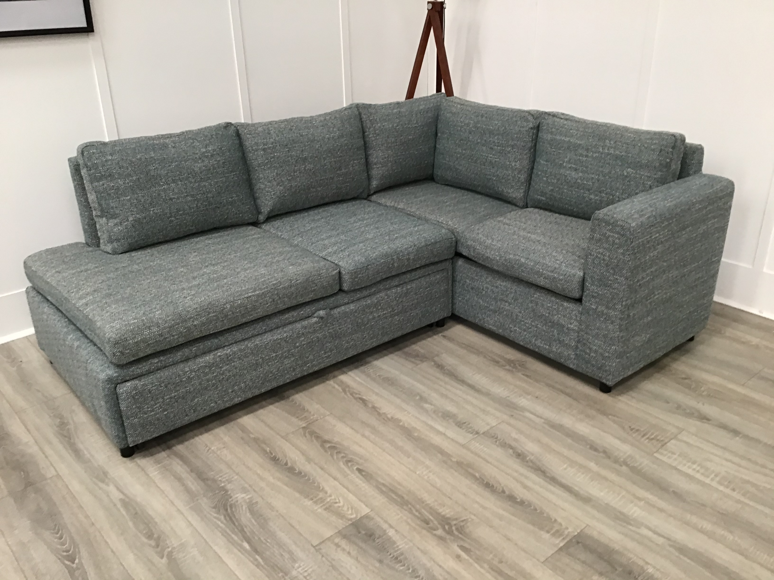 Central Corner Sofa Bed With Storage In Green Fabric For Hartford Storage Sectional Futon Sofas (View 4 of 15)